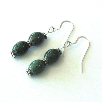 Earrings made from green ceramic oval beads by JimDavisDesigns