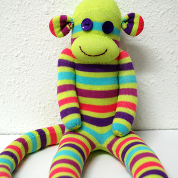 green sock monkey, stuffed animal - green with pink, blue and purple stripes. OOAK