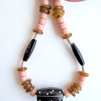 Eclectic beaded necklace with Indian horn and wood inlay beads, Ethiopian silver beads, Ghanian glass beads and peach Native American beads