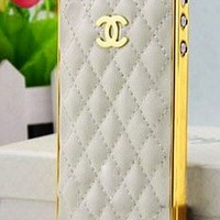 Designer inspired Chanel CC Iphone 5 Leather Case,high quality ,luxury style and touch feeling, Hard back case, white with golden logo and frame .BUY it can get one matched Free 3.5mm diamond Anti dust Ear Cap Dock Plug:Amazon
