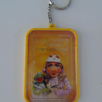 Vintage Keychain The Muppets Show Miss Piggy Kermit The Frog The Road to Success Is Always Under Construction circa 1981 Henson Associates