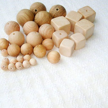 https://www.etsy.com/listing/106375696/15-mm-wooden-beads-100-pcs-natural?ref=shop_home_active_6