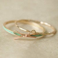 tied with a bow bangle set in mint at ShopRuche.com