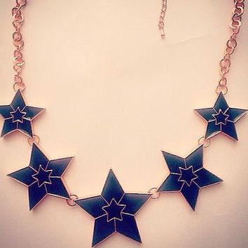 Gorgeous Black & Gold Star Enamel Necklace with rose coloured metal chain.