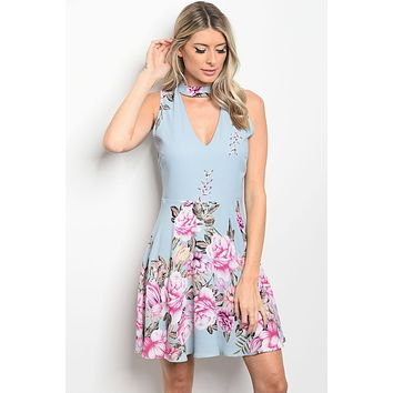Ladies fashion sleeveless floral print skater dress that features a choker and v neckline