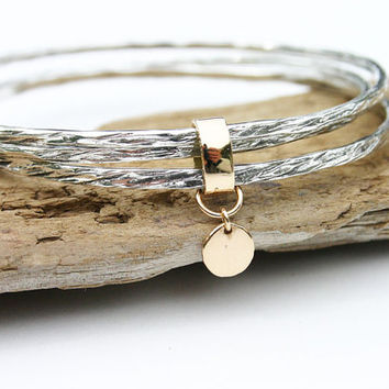 Bangle bracelet set, sterling silver and 14k solid gold. Mixed metal set of three bangles. Hammered set of bangles with gold disc detail.