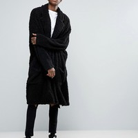 ASOS Extreme Oversized Duster Coat In Black Borg at asos.com