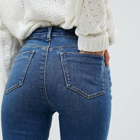ASOS DESIGN Ridley high waist skinny jeans in bright blue wash at asos.com
