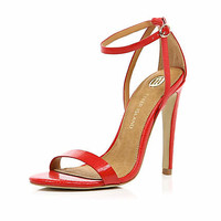 RED BARELY THERE STILETTO SANDALS