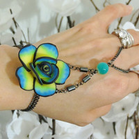 "Rose beaded ""Slave Bracelet"" Ring. Blue, Aqua, Yellow and Black Polymer Claw Rose Flower. Hematite Beads. Fits wrists 6-8 inches."