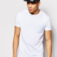 ASOS | ASOS Longline T-Shirt With Mosaic Print Pocket And Relaxed Skater Fit at ASOS