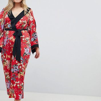 ASOS DESIGN Curve Kimono Jumpsuit With Tipping In Floral at asos.com