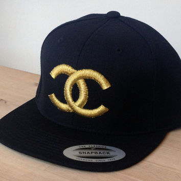 Chanel SnapBack Cap Metallic Gold Custom Embroidered Logo.  Made to order quality snap back hats and designs