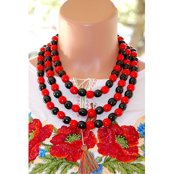 Artisan crafted wood triple beads. Red and black