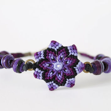 Macramè textile bracelet with mandala flower and beads violet black