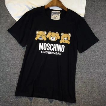 ''MOSCHINO''Hot letters print T-shirt topColor: Blue, White  Size:S,M,L  Fabric:Cotton  Collar: Round collar  Style:T-shirt/Leisure  Version:Loose type