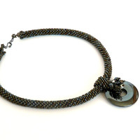 Beaded necklace, bead crochet necklace, beadwork hematite donut pendant, hematite-bronz colors