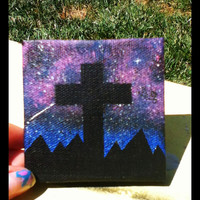 Galaxy Canvas Painting with Silhouetted Cross.