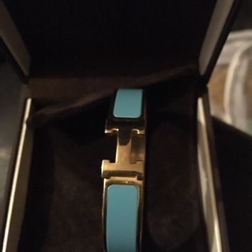 Hermes H bangle in Blue and Gold