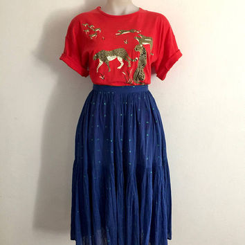 Sensational 1970s 'Claudia Sträter' blue cotton ruffled party skirt with woven green lurex patterning