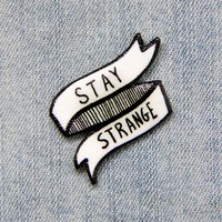"""Stay Strange"" Black and White Lapel Pin"