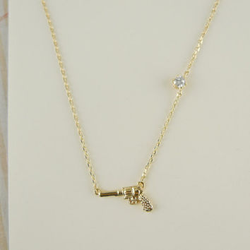 gun necklace in gold by LemonTreeLand on Etsy