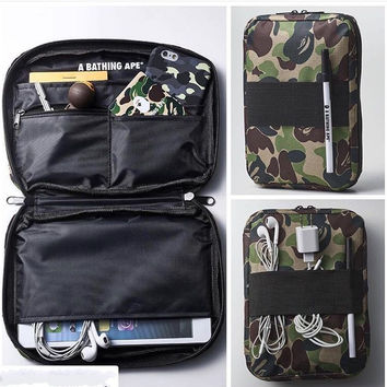 Bape Holding a passport bag [10507735687]