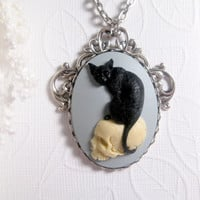 Black Magic Cat And Skull Necklace On Light Blue
