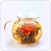 Numi Organic Tea Glass Teapot - Teahouse | Our unique, hand-blown glass teapot is the best way to watch a Flowering Teas™ bloom. It serves up to 14 ounces (420 ml.) of tea.