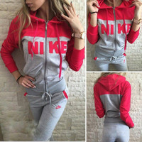 Nike Fashion Hooded Zipper Sport Running Set Two-Piece Coat Pants Sportswear