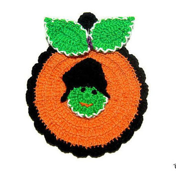 Orange Green and Black Halloween crochet pumpkin potholder, presina zucca arancione verde e nera per Halloween all'uncinetto