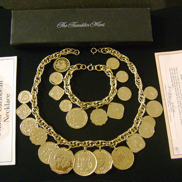 The FRANKLIN MINT 1986 The Golden Caribbean Genuine Authentic Coins Charms Necklace Bracelet Set 24K Gold Plated Certificate of Authenticity