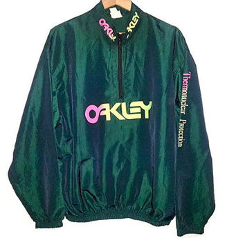 Vintage OAKLEY Thermonuclear Protection iridescent neon windbreaker jacket 90's surf skate hipster Color Green One Size Fits Most