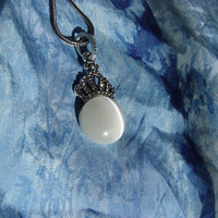Cats-eye moonstone silver necklace with rhinestone crown.