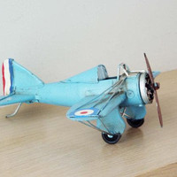 Turquoise miniature aeroplane, retro collectible,vintage, collectible, tin, airplane miniature, movable propeller and wheels, early nineties