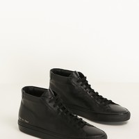 Totokaelo - Common Projects Black Original Achilles Mid Top Sneaker - $423.00