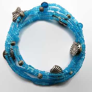 "seed bead bracelet turquoise, friendship bracelet. Set of 5. Stretch , charms, ""sea theme"" charms, bigger blue glass beads. Bali beads"