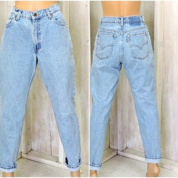 Vintage Levis 550 jeans / relaxed  tapered mom jeans  30 X 31 size 7 / 8  LEVI'S 100% cotton high waisted light wash peg leg Levi jeans
