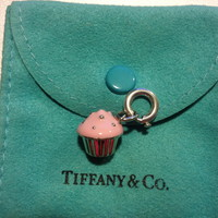 Tiffany & Co. -  Cupcake charm with pink enamel finish in sterling silver on a chain.