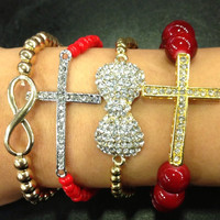 Arm Candy Set of 4 Red & Gold Crystal Cross, Bow, Infinity Sideways Bracelet Set