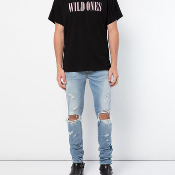 Amiri Faded Distressed Jeans - Farfetch
