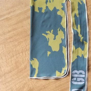 Green camo. Water resistant double sided compression rag.