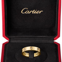 LOVE wedding band, 8 diamonds: LOVE wedding band, 18K yellow gold, set with 8 brilliant-cut diamonds totaling 0.18 carat.