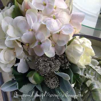 Winter wedding bouquet with brooches, hydrangeas and peony bulbs. Spring, Summer, Fall