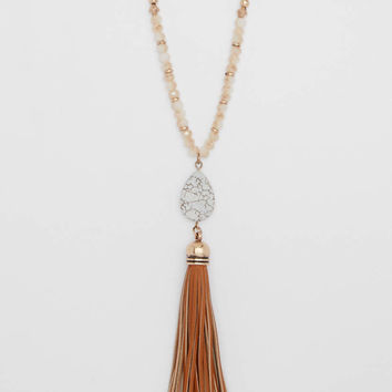 faux howlite pendant necklace with faux leather tassel | maurices