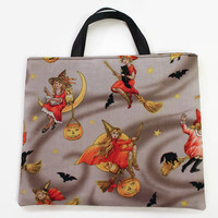 Reusable Fabric Trick or Treat Bag-- Vintage Girl Witch on Broom Print with Black Lining and Satin Ribbon Handles
