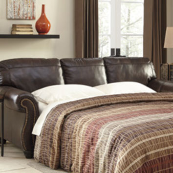 Bristan collection walnut colored leather match upholstered queen sleeper sofa with nail head trim