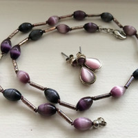 Vintage Monet teardrop earrings with purple tiger eye type stones and similar non-signed necklace choker