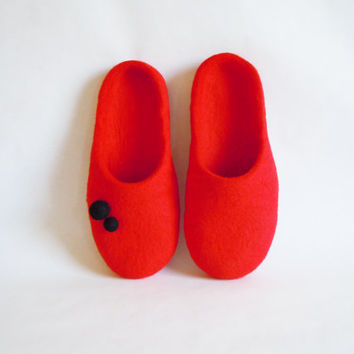 Hand made felted slippers of custom chosen color.