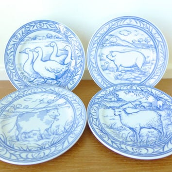 Four Williams Sonoma Brittany farm plates, cow, lamb, geese and pig